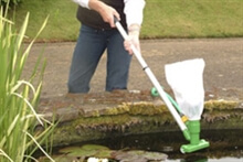 Garden pond maintenance using a pond vac