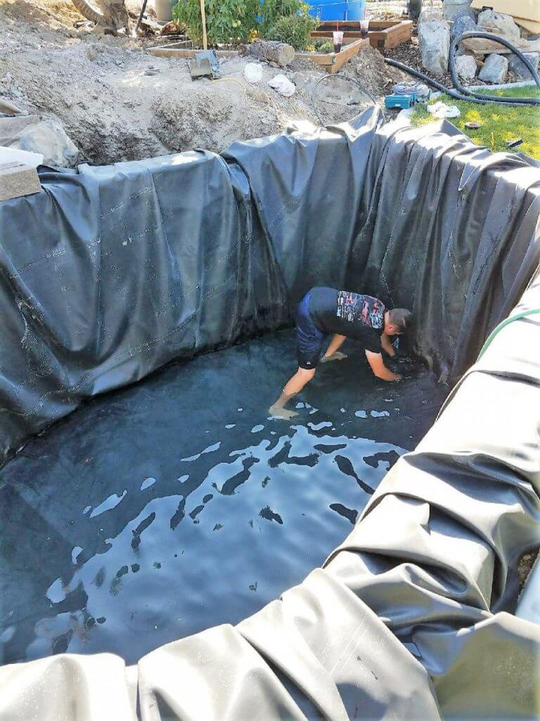Installing a flat sheet rubber pond liner offers great design flexibility