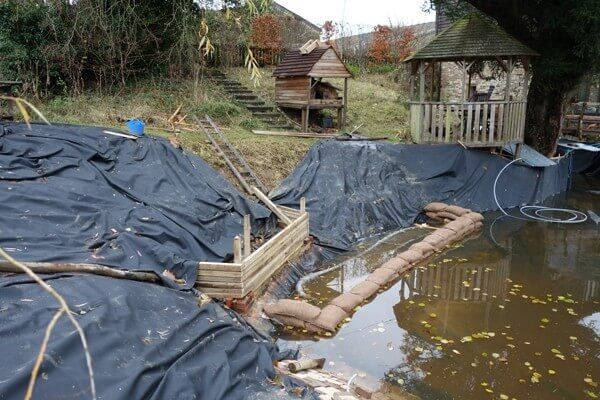 Laying the pond liner and the early stage of filing the pond