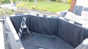Fitting a box-welded pond liner