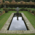 Box welded pond liner contains the water in this rectangular garden pond