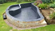 Vertical sided raised pond ideal for a fish pond